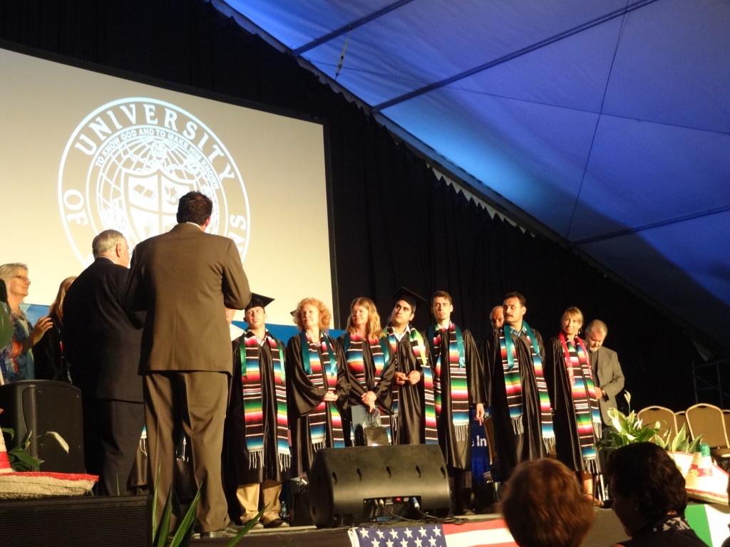 University of the Nations graduates on stage